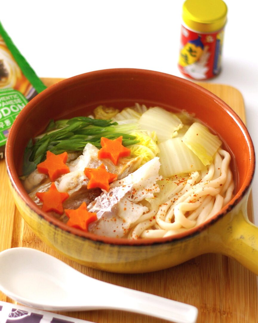 Hot pot style udon topping with cod, nappa cabbage, carrot, shichimi pepper