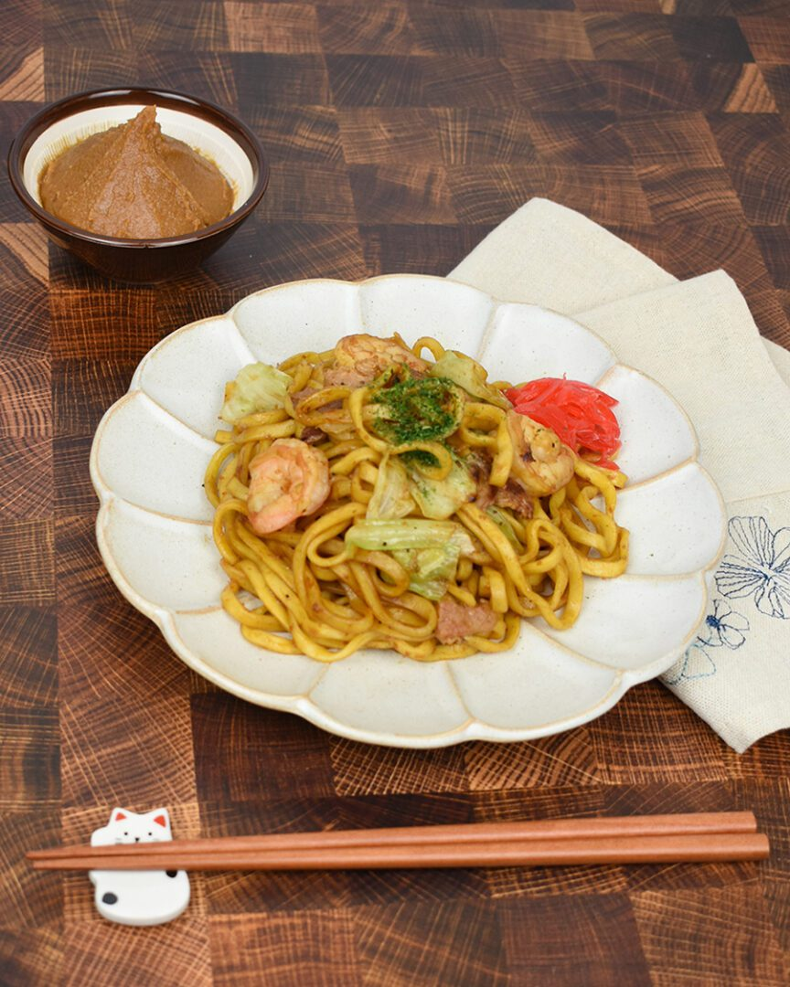 Premium Savory Miso Yakisoba topping with shrimps, red ginger, and aonori