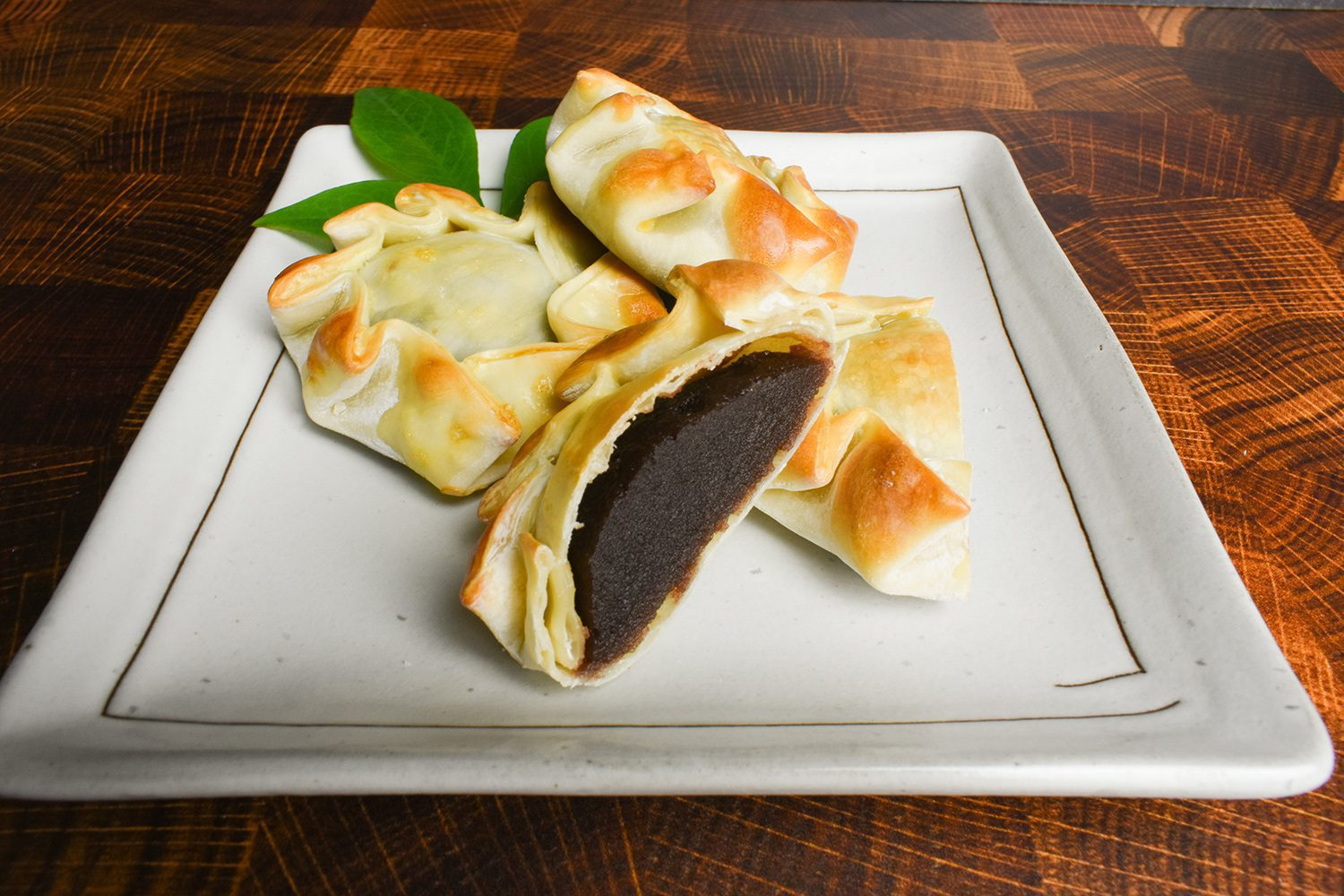 Empanadas, originated in Spain and Portugal, using gyoza wrapper filling with red bean