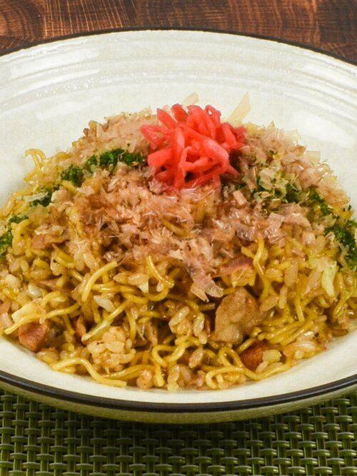 Soba meshi, originated from Kobe, Japan - a mixed dish of yakisoba and fried rice topping with bonito flakes, red ginger, and aonori