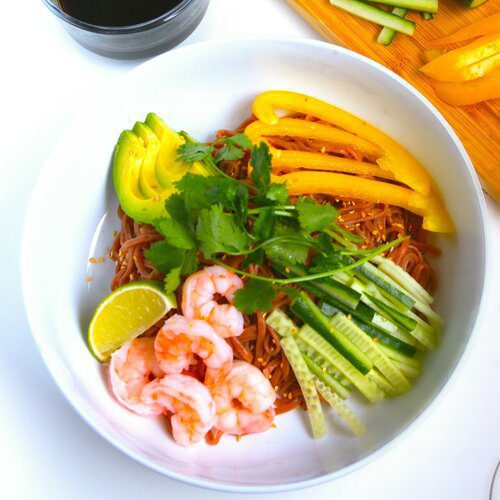 Shrimp and avocado hiyashi chuka (cold noodles) with Beet Noodles topping with cucumber, ham, and shredded eggs