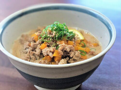 Signature Miso Ramen with soup mixed with soy milk topping with ground pork and sweet yellow bell peppers