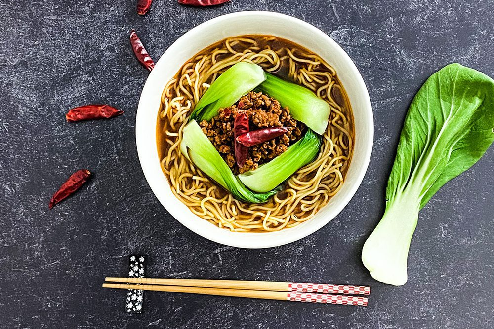 Signature Spicy Miso Ramen with a spicy and savory ground pork (soboro) and bok choy