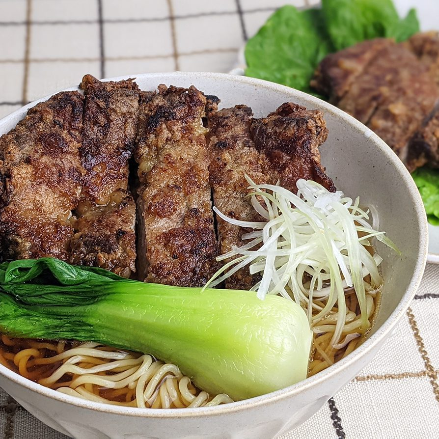 Shoyu ramen with pork spare ribs topping with bok choy