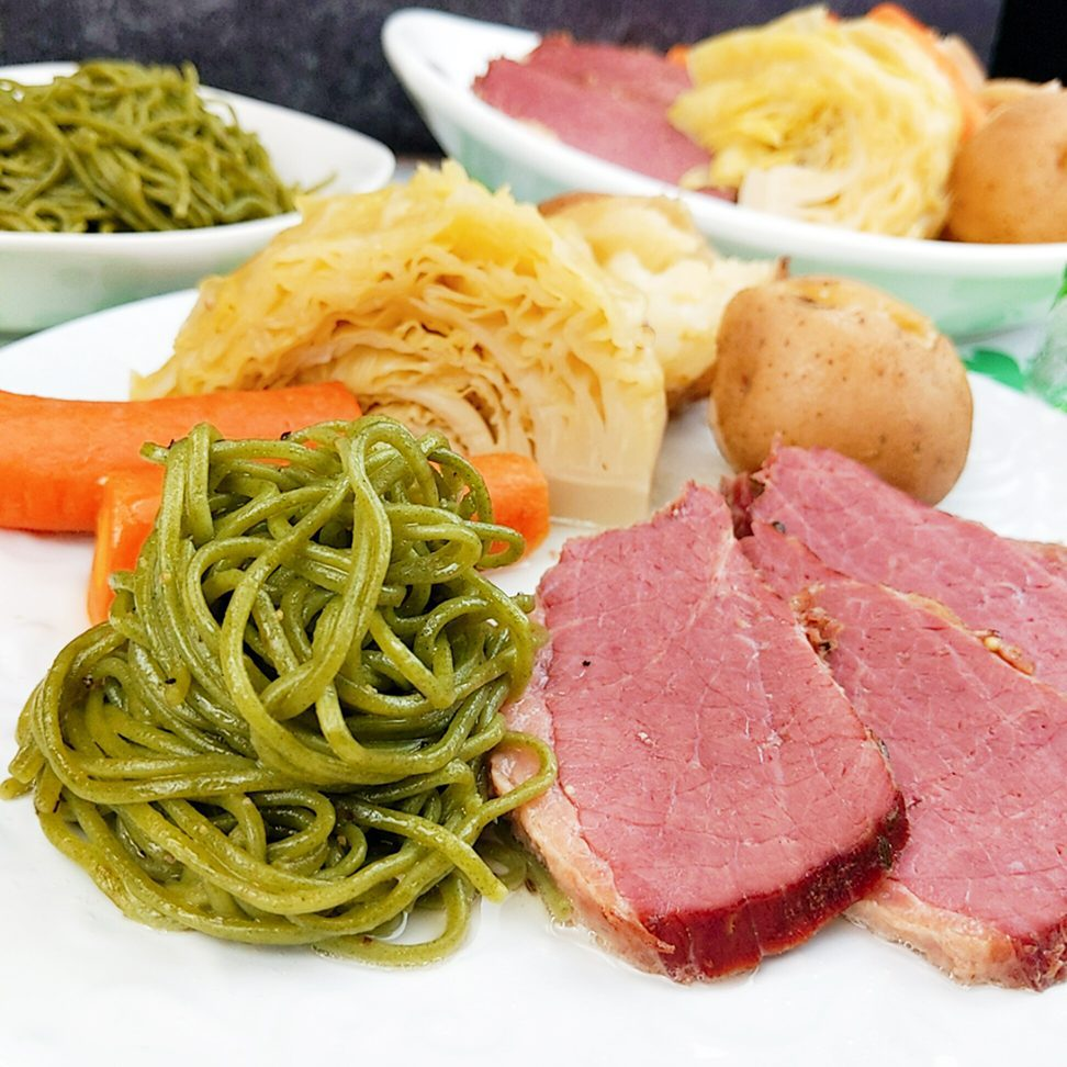 Corned beef and cabbage with Kale Noodles recipe includes carrots, cabbage, potatoes, corned beef pressure cooked. Side with Kale Noodles to add some green to St. Patrick's Day.