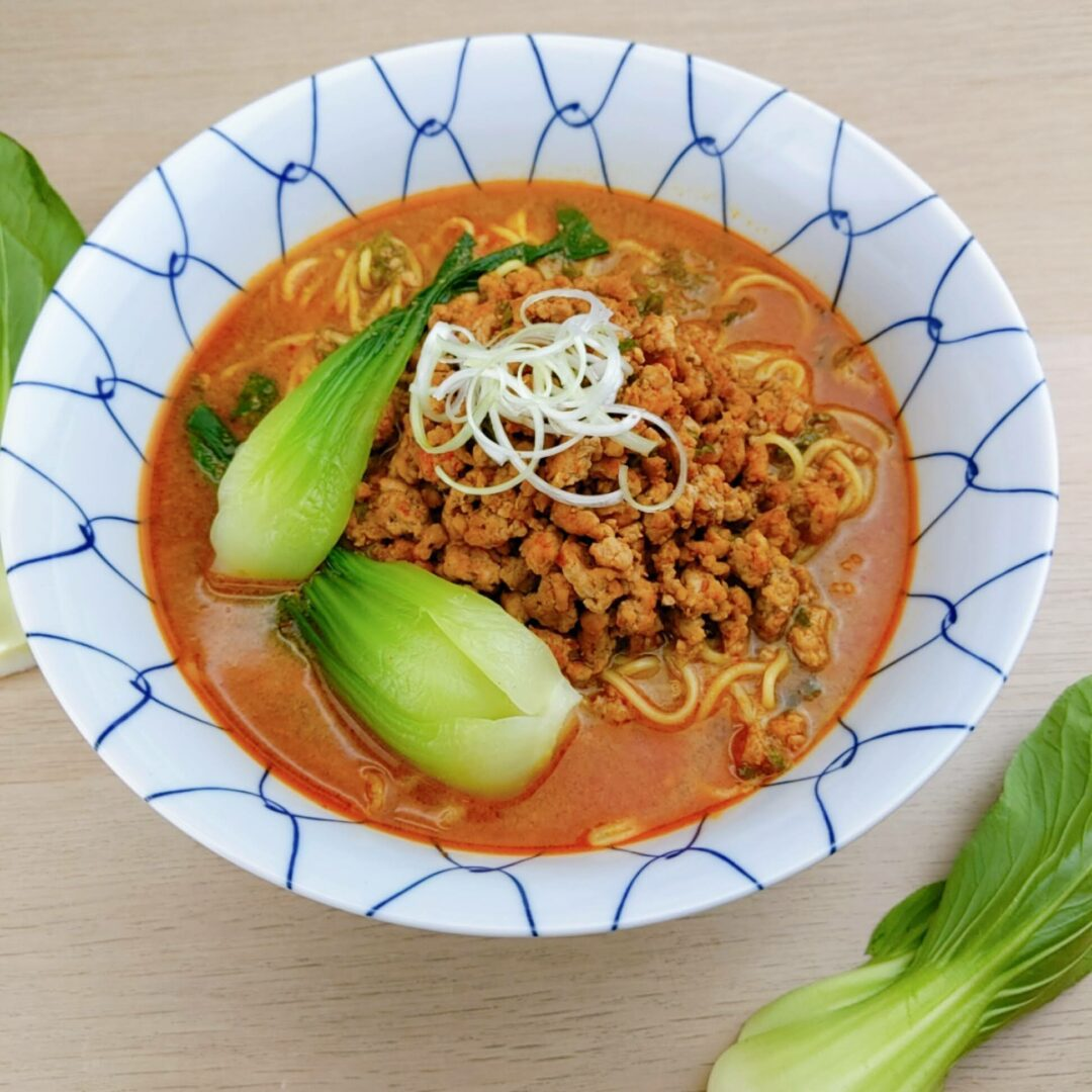 Myojo-style Tantanmen made with Signature Spicy Miso Ramen using peanut butter topping with sliced green onions and bok-choy