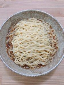 Deviled egg on shoyu ramen nest Step 5 - noodle soak in the flavor