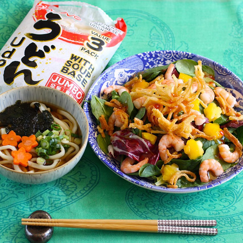 small bowl udon serving with a crispy fried udon salad topping with shrimp and paprika