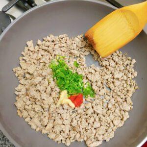 Tahini Tantanmen - Step 3 - add ginger, minced green onions, and doubanjiang sauce to the ground pork