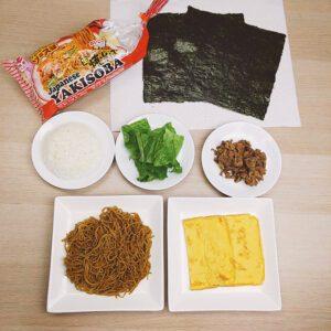 Yakisoba Onigirazu (No Wrap Rice Ball) Step 1 - All ingredients (Myojo Signature Original Yakisoba, Nori Seaweed, rice, leaf lettuce, thinly sliced pork, and egg)